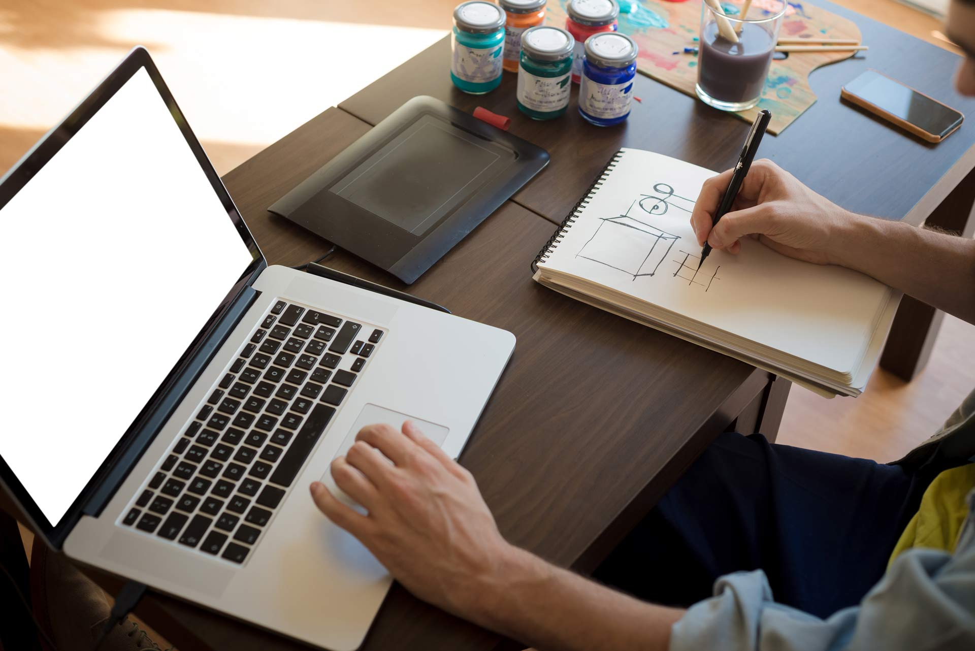 Handsome hipster modern man designer working home using for At home graphic design